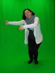 Judy in front of the green screen.